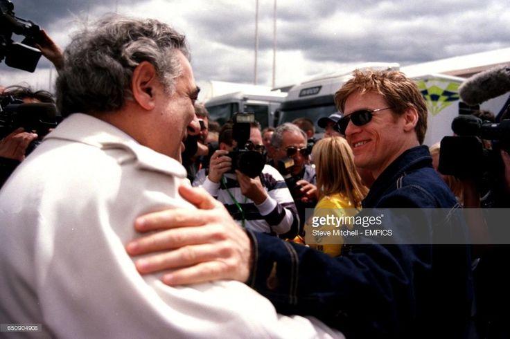 Canadian singer Bryan Adams (r) greets Placido Domingo (l) at the Austrian Grand Prix