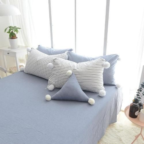 Stripe or blue cotton pillow cases with pom poms looks better than a plain white pillow case, if you ask me.