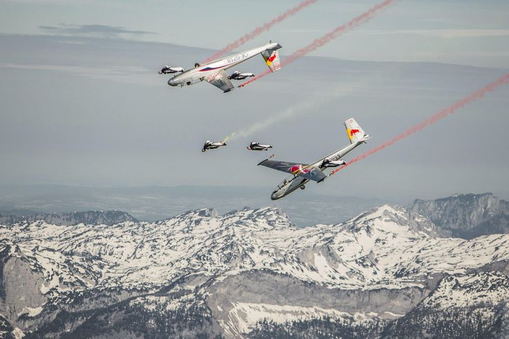 The Red Bull Skydive Team and two Blanik gliders from the Blanix Aerobatics Team in close formation near Niederöblarn, Austria.