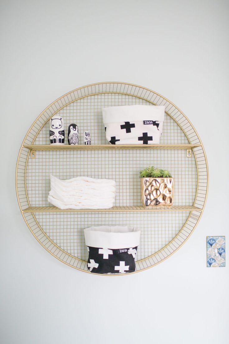 Round gold wired shelf for the nursery. A very modern shelfie!