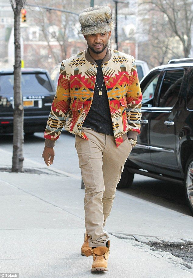 He's trying: Usher wore the raccoon tail hat on Sunday with a Navaho print jacket and tan trousers