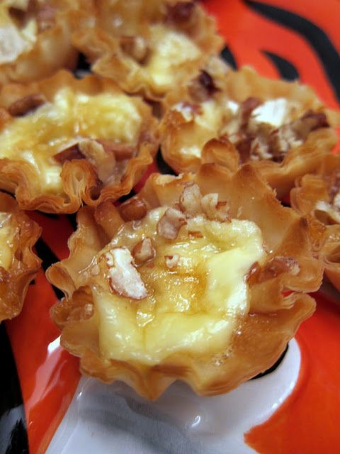 Baked Brie Bites. So easy! Preheat oven to 350. Place a cube of brie in each phyllo tart. Top with 1/2 tsp brown sugar, chopped pecans, honey. Bake until brie is melted. oh heavens YES