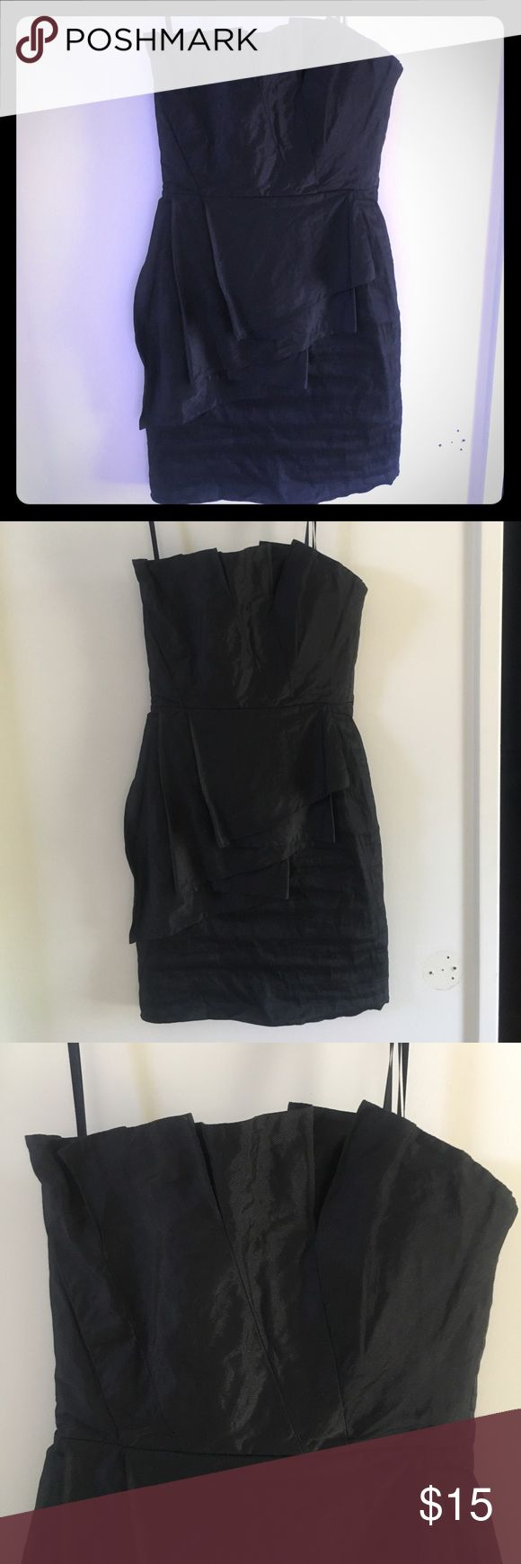BCBG Max Azria black strapless minidress Size 2 Authentic BCBG MaxAzria short strapless cocktail dress. It needs to be steamed/ ironed (wrinkled) . The dress is intact but the liner is peeling off. Good condition. Priced accordingly. BCBGMaxAzria Dresses Strapless