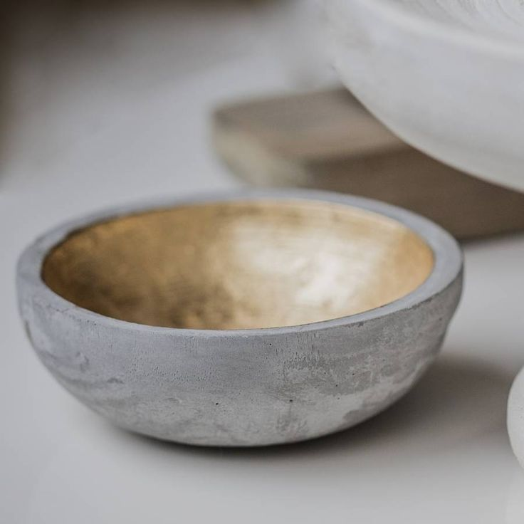 Concrete home accessories are big thing these days. I like the contrast between the cold grey and warm gold. Concrete And Gold Bowl by THE LIVING LOUNGE #NOTHS