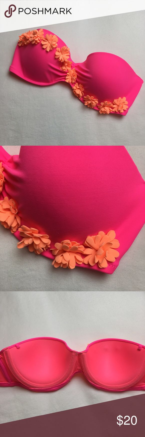Pink and orange bandeau VS bikini top 32D Excellent condition, but does not come with strap. Hot pink with orange flowers. Size 32D. Top only. Last picture is to show fit only. Reasonable offers welcome! Victoria's Secret Swim Bikinis
