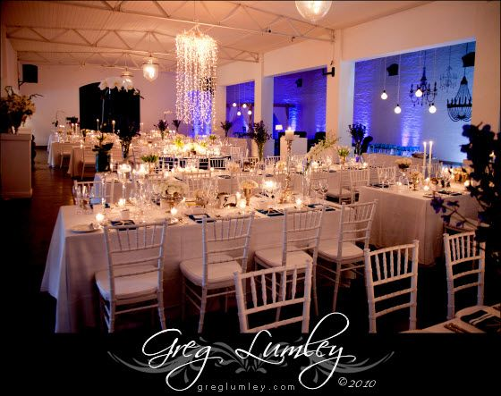 Classy Tiffany chairs, chandelier, long Tables wedding reception ceremony layout