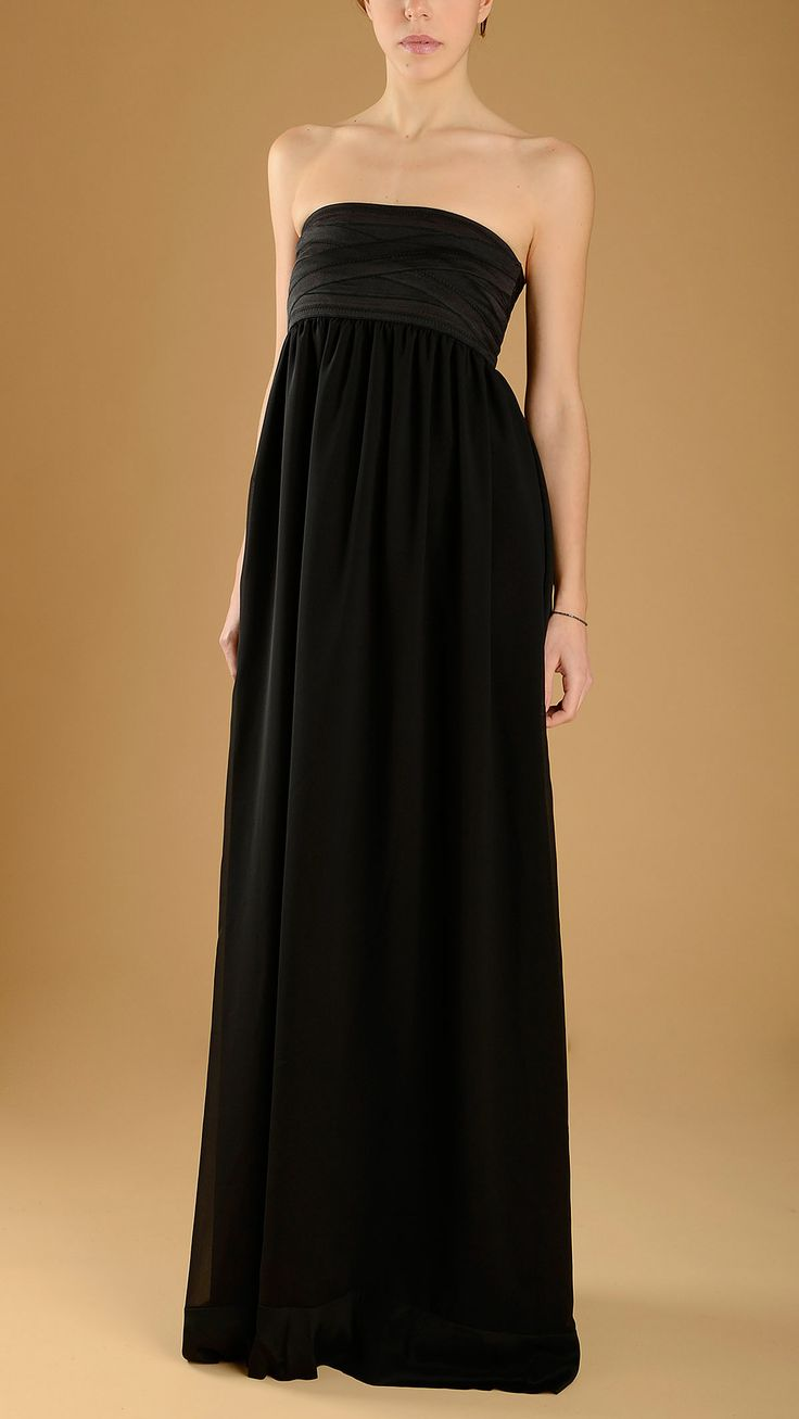 Long, strapless black evening dress.
