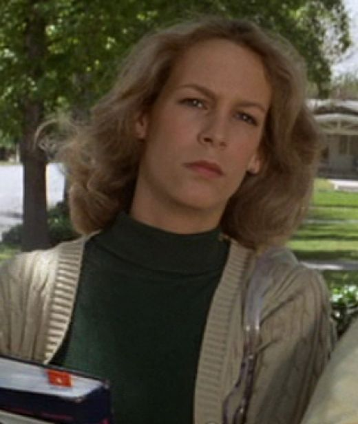 Laurie Strode (Jamie Lee Curtis) , spooked after her first sighting of Michael Myers behind the bushes of Haddonfield.