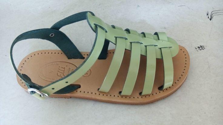 Light green handmade gladiator leather sandals designed by Elli lyraraki