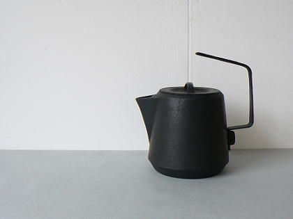 Iron teapot.
