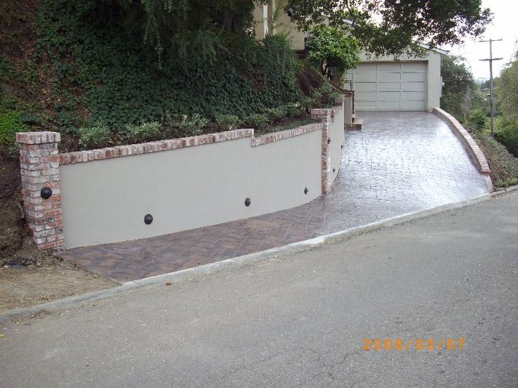 Concrete Retaining Wall With Drainage And Brick Cap And