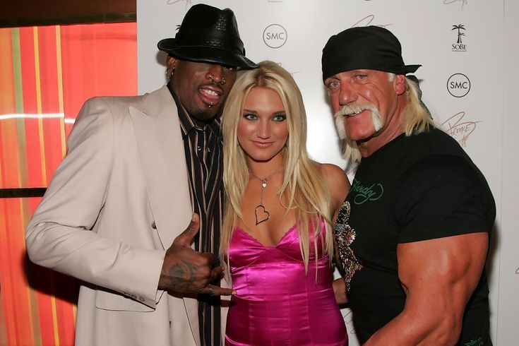 Hulk Hogan Dennis Rodman Photos - (L to R) Dennis Rodman, Brooke Hogan and Hulk Hogan arrive at the release party for Brooke's new album 'Undiscovered' on October 24, 2006 in New York City. - A Day In The Life With Brooke Hogan