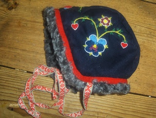 Sinple embroidery on girl's winter hat (lined with sheep)