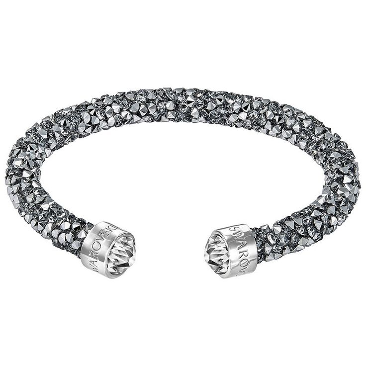 Swarovski Crystaldust Cuff, Gray, S 5255912. Swarovski's Crystal Rock technique. Encrusted with chrome-effect crystals. Size: 2 / 1/2 inches. Article no.: 5255912.