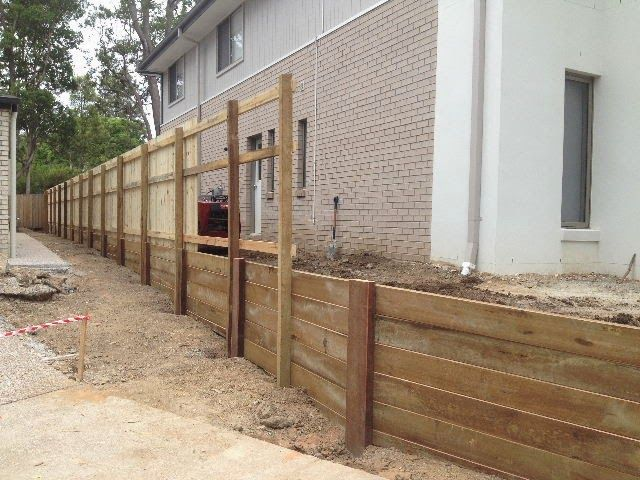 Image result for timber fence on top of retaining wall