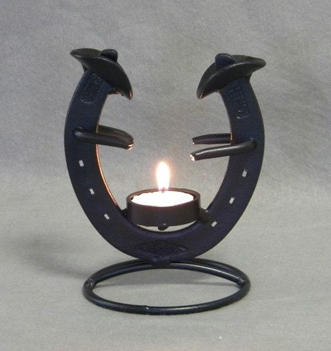 camp fire cowboys horse shoe tea lite sculpture.