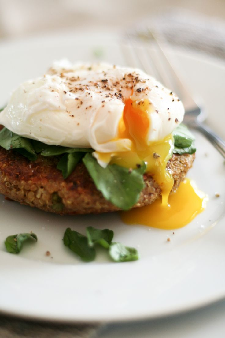 A delicious poached egg sitting on a bed of delicate watercress, set over a delicious warm and crunchy quinoa cake. Tastes good AND is good for you.