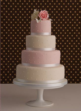 The alternated colours of this 4-tiered modern pearl-accented wedding cake make for an eye-catching delight.