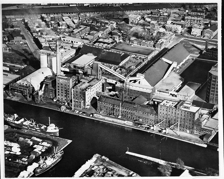 REDPATH REFINERY MONTREAL 1953 Aerial view of Redpath Sugar 's Montreal Refinery in 1953, showing the Lachine Canal and part of Point St. Charles. (Redpath Sugar Museum Collection)