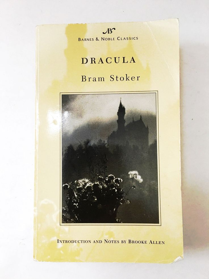 Dracula book by Bram Stoker. Soft cover book. Brilliant love story. Translyvania castle supernatura book.