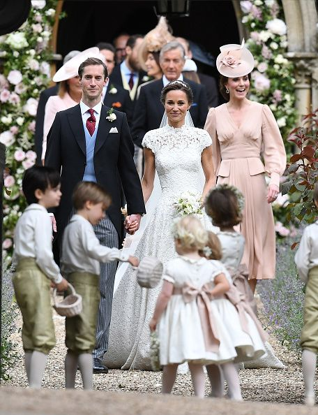 Pippa Matthews and James Matthews exit the church after their wedding ceremony followed by Catherine, Duchess of Cambridge (R)at St Mark's Church on May 20, 2017 in Englefield Green, England.