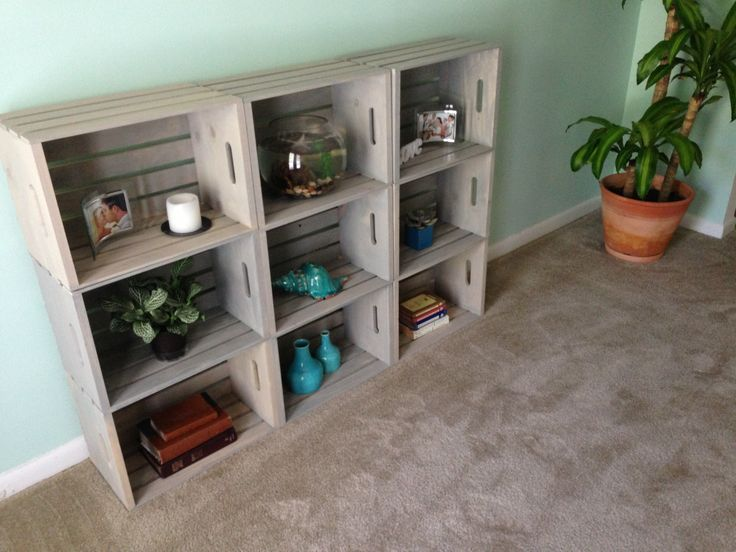 "DIY wooden crate bookshelf. Stained with ""driftwood"" . Crates were 8.99 from JoAnn Fabrics"