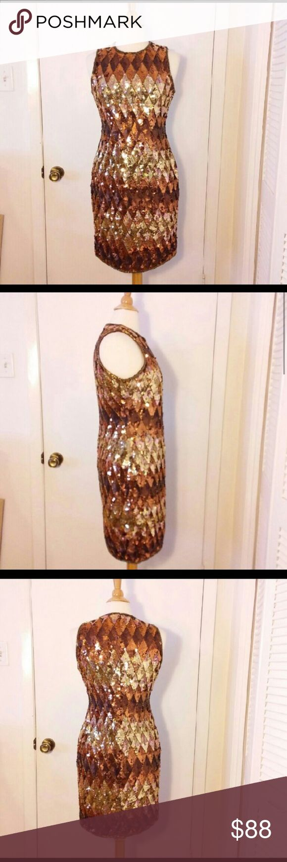 A.J Bari Bronze & Gold Sequin Dress Size 12 Fabulous evening shift dress with diamond patterned sequins in shades of bronze and gold. Honestly my favorite of all times. I've gotten so many compliments in this dress. Everyone noticed me in the room when I walked in and everyone will notice you as well! Such a glam dress! Measurements: 37' long, 13' across shoulders, 19' across bust, 16' across waist, 20' across hips and 18' across hem. Great condition and amazing quality. A.J. Bari Dresses…