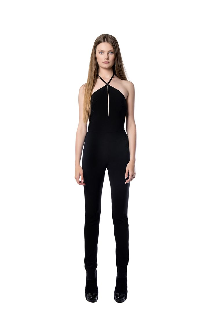 Sleeveless black crepe jumpsuit  A form – fitting light weight crepe jumpsuit is the best option for your next party. The low – V back accentuates a slim waist, while define your silhouette. Pair it with high heels and a clutch.