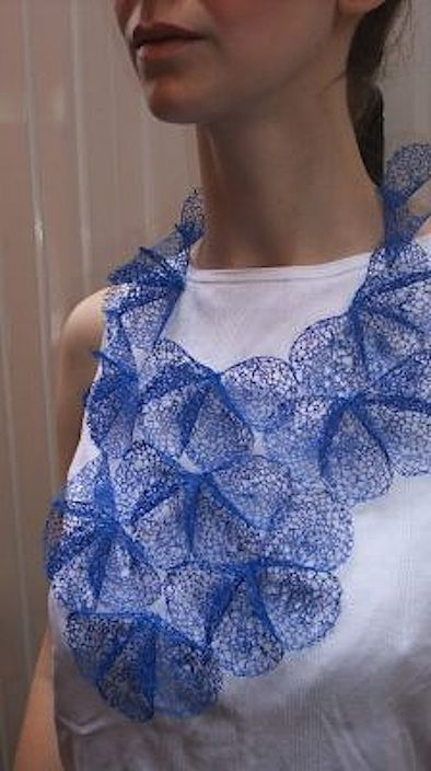 Laura Anne Marsden is a textile designer who created a technique for transforming waste plastic bags into lace. She uses a combination of traditional hand-stitch and needle lace-making, along with various processes to change the properties and appearance of the plastic bags