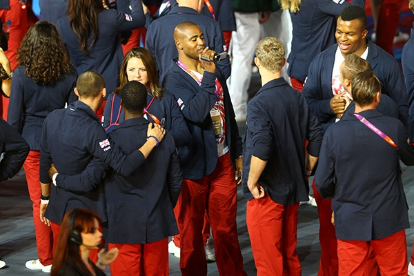 Athlete Mark Lewis-Francis of Great Britain films teammates during the Closing Ceremony on Day 16 of the 2012 Olympic Games at Olympic Stadium on August 12, 2012 in London, England. (Photo by Paul Gilham/Getty Images)
