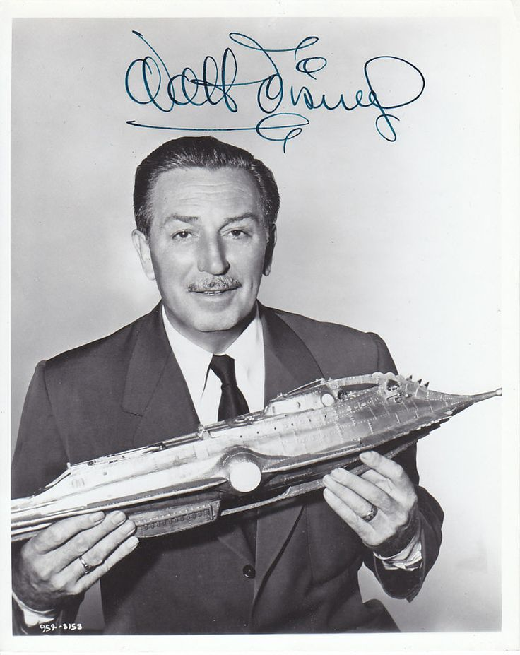 Walt Disney holding the Nautilus from 20,000 Leagues Under the Sea (1954)