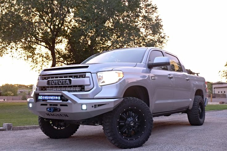 Desert Dawg's 2015 Toyota Tundra 1794 Edition CrewMax 4x4 with Toytec BOSS adjustable suspension, custom painted ICI Magum bumpers with skid plate, Smittybilt 13K winch, Rigid 20-inch Blue Radiance LED light bar, Rigid 30-inch LED dual-row light bar, Rigid D2 LED fog lights, custom painted TRD PRO grille insert, surround, hood bulge, Cooper STT PRO tires mounted on TIS wheels,and much more,
