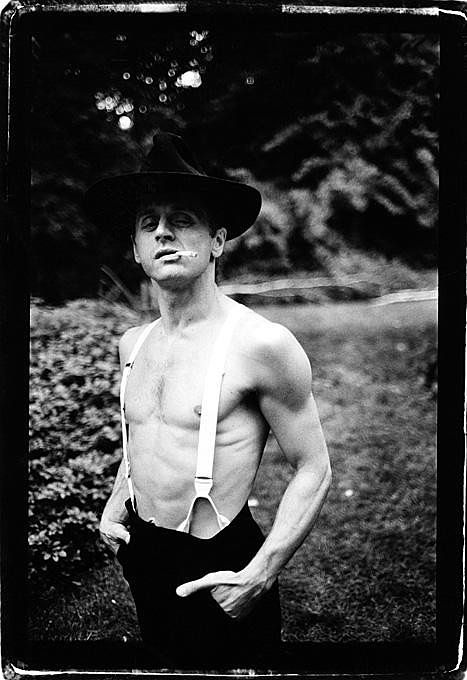 Mikhail Baryshnikov. I'm very surprised to see him smoking. I thought dancers were supposed to keep in top shape. Perhaps it's just a gag he did for the cameras.