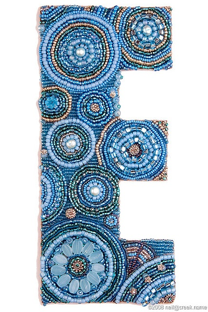 Dazzling Beaded Letter E be amazing to have beaded lettering on our banners of Krishna names