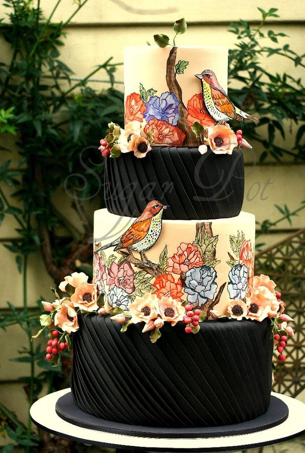Inspiration for this cake came from a piece of fabric. I wanted to incorporate different techniques for the tiers. Top and third tier are hand painted with the 2D birds. Second and tier were covered with pleats to bring  contrast and depth into the design.