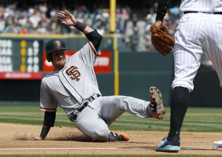 Giants-Dodgers tickets plunge to $6 after brutal start  -  April 24, 2017 San Francisco Giants' Joe Panik, left, slides safely into third base to advance on a sacrifice fly hit by Buster Posey as Colorado Rockies third baseman Nolan Arenado looks for the throw in the fourth inning of a baseball game Sunday, April 23, 2017, in Denver. Colorado won 8-0. (AP Photo/David Zalubowski)