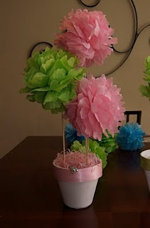 tissue pom pom centerpiece, my sister made these for my baby shower and were such a huge hit! They are now wall decorations! Try it :)