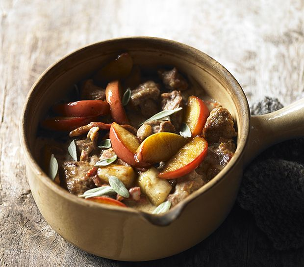 This delicious pork and apple casserole recipe celebrates a classic pairing. More delicious seasonal recipes at countryliving.co.uk