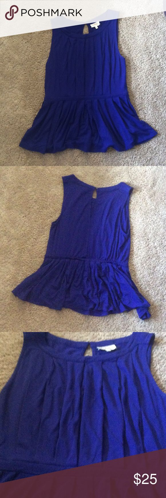 Jersey pleated peplum sleeveless top Cobalt blue sleeveless peplum top with pleats. Really soft and comfortable. Button closure on back neck area. I got this at Anthropologie and only I've only worn it once or twice. In great condition. Price is firm. Anthropologie Tops Tank Tops
