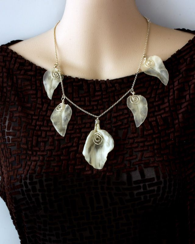 Ikiaikainen -kaulaketju, Light and delicate, but lasting jewellery made of ecological material, parchment.
