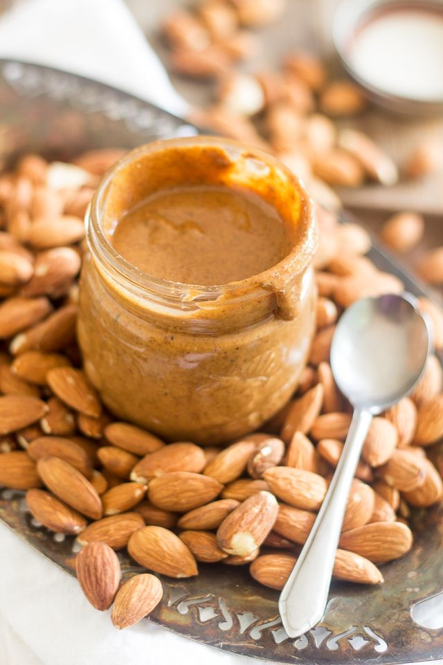 Quaintly-shaped jar, nuts provide backdrop with antique platters and silver spoons to complement