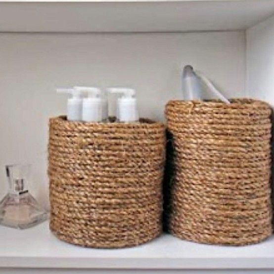 Glue rope to your used coffee cans! Cheap, chic organizing. Could be done to other containers.
