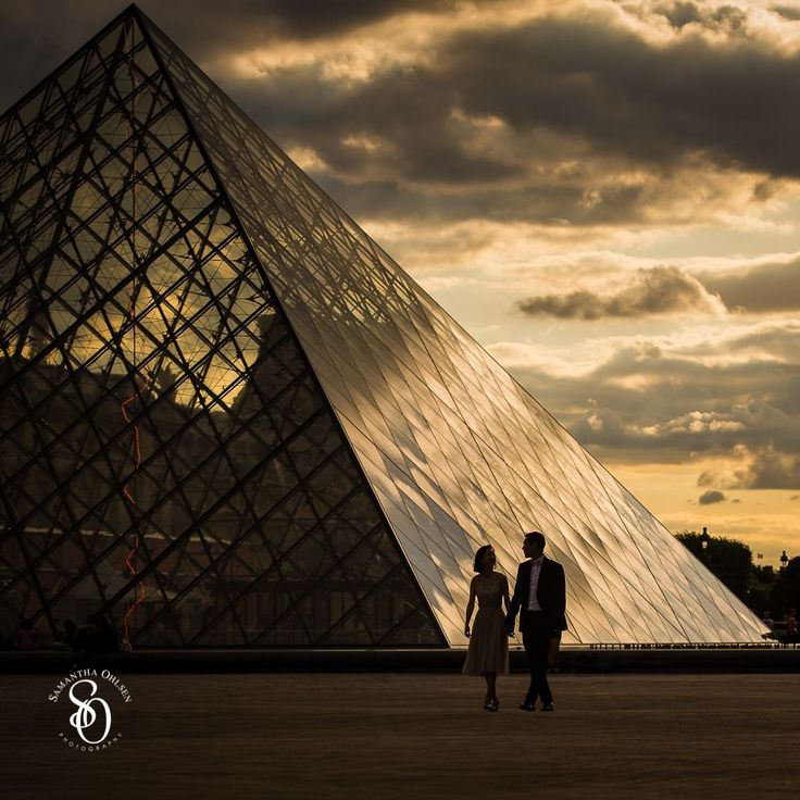 Sunset at the Louvre. Paris is a dream destination for a #prewedding photo shoot. The #louvre was an amazing location with the #sunset behind the glass pyramid. This couple was a part of #aeuropeanlovestory artistic project during the European Summer of 2015.