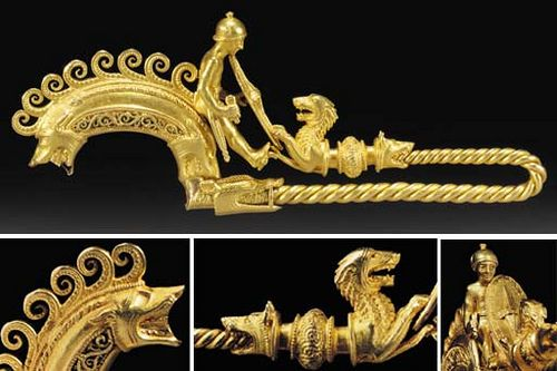 #celtic A HIGHLY IMPORTANT CELTIC LA TÈNE GOLD WARRIOR FIBULA 3RD CENTURY B.C. Finely detailed, with a youthful warrior confronting an attacking wolf-like hound,