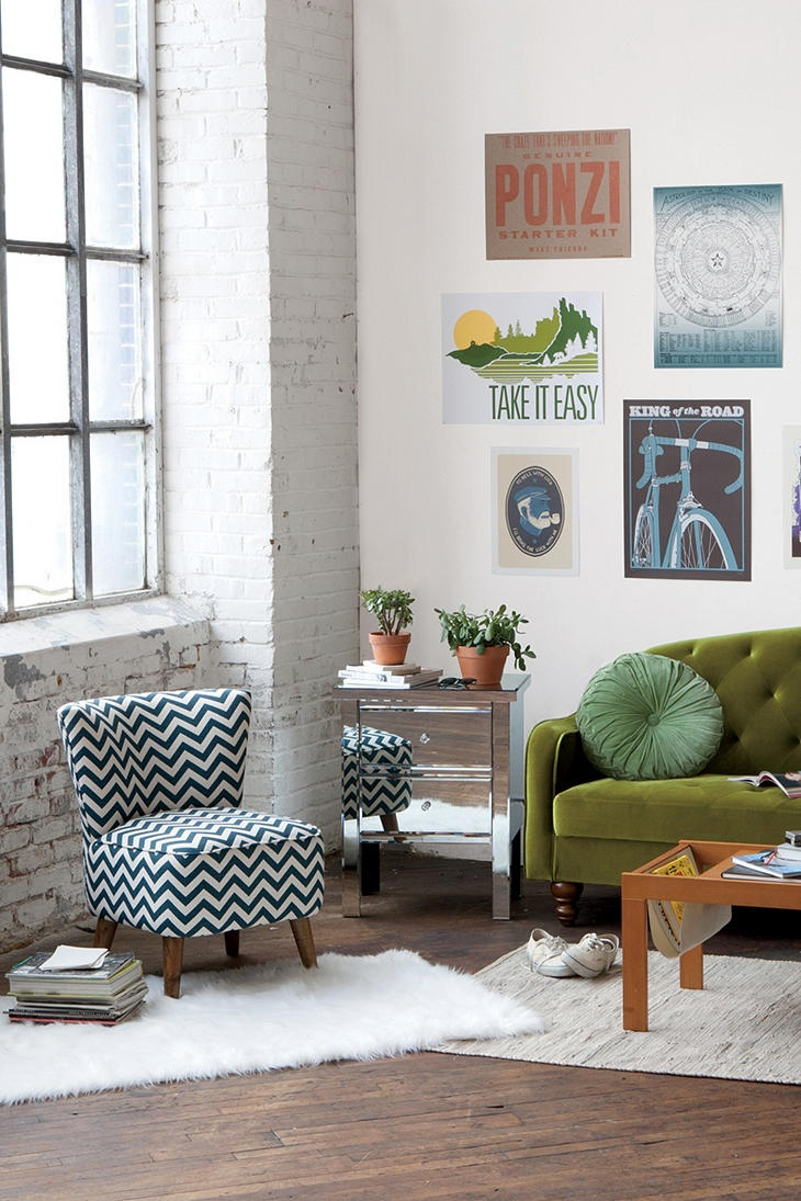 love the bright light, olive green couch and striped chair