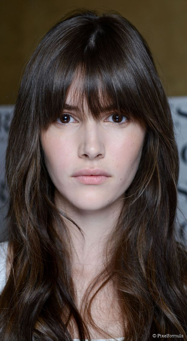 BANGS | French girl bangs | fall near underside of the eyebrow; sides cut with a slight curve to blend with rest of hair
