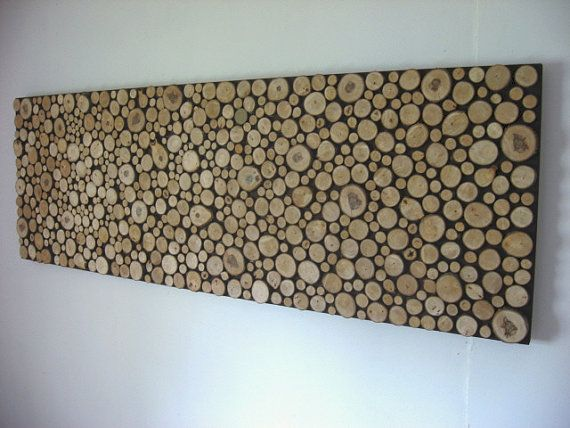 branch cross sections glued onto a painted piece of particle board
