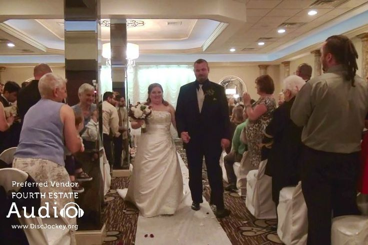 """The newlyweds make their recessional to Bruno Mars' """"Marry You."""" http://www.discjockey.org/real-chicago-wedding-may-2-2015/"""