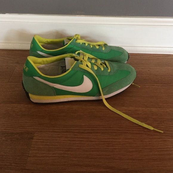 Nike tennis shoes! Great condition! These Nike tennis shoes are bright and springy! Worn once or twice. They are too big for me. Cute for working out or wearing casually. Nike Shoes Athletic Shoes
