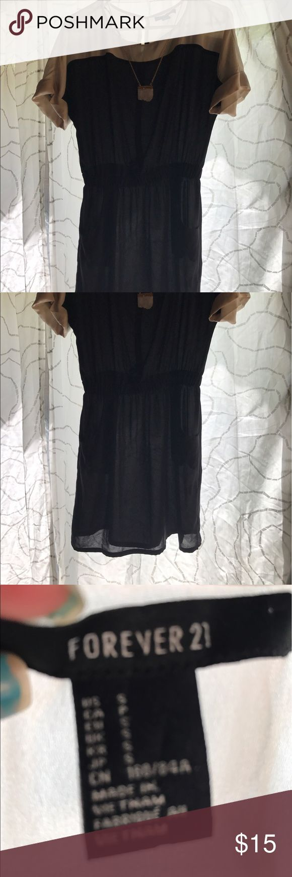 Forever 21 dress Black and ivory with a eye hole closure in back. Sheer material would require a camp or slip. This dress has pockets! Forever 21 Dresses Mini